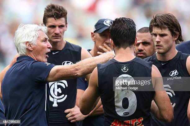Blues coach Michael Malthouse speaks to his players at three quarter time during the round four AFL match between the Carlton Blues and the Melbourne...