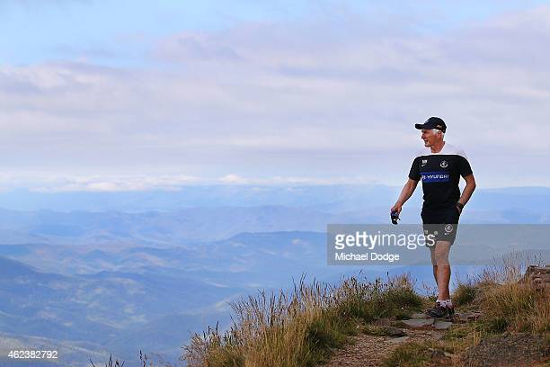 Blues coach Michael Malthouse walks on the summit of Mount Buller during the Carlton Blues AFL training camp on January 28 2015 in Mount Buller...