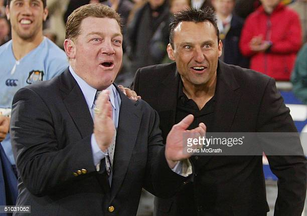 Blues coach Phil Gould celebrates a Blues try with Assistant coach Laurie Daley during game three of the NRL State Of Origin series between the New...