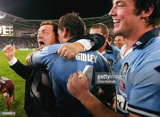 Blues' coach Phil Gould hugs Matt Gidley as the Blues celebrate their one point victory during game one of the NRL State of Origin Series between the...