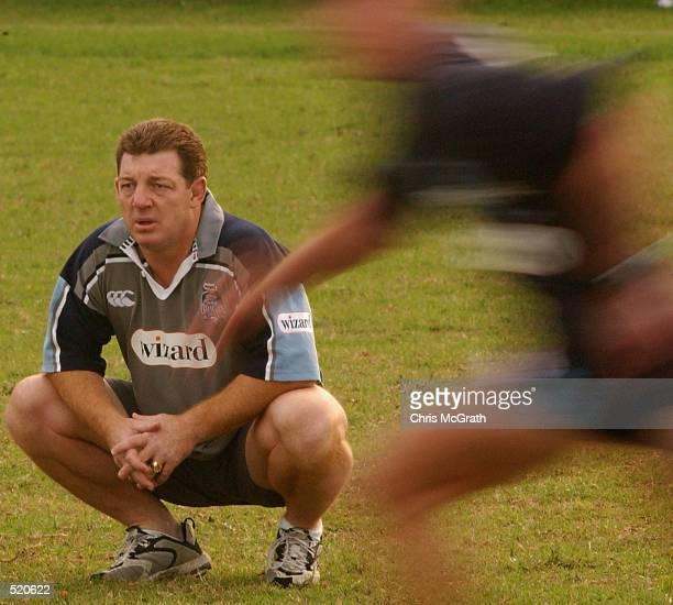 Blues Coach Phil Gould keeps an eye on his team during the first training session for the NSW Blues held at Coogee Oval Sydney Australia on May 13th...