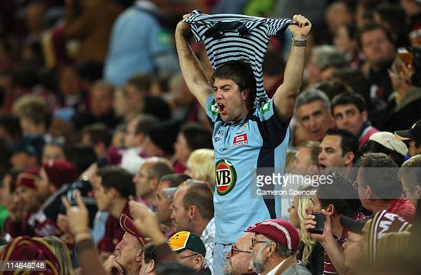 Blues fan enjoys the atmosphere during game one of the ARL State of Origin series between the Queensland Maroons and the New South Wales Blues at...