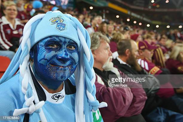 Blues fan waits for the start of game two of the ARL State of Origin series between the Queensland Maroons and the New South Wales Blues at Suncorp...