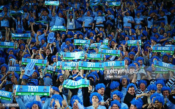 Blues fans celebrate a try during game one of the State of Origin series between the New South Wales Blues and the Queensland Maroons at ANZ Stadium...