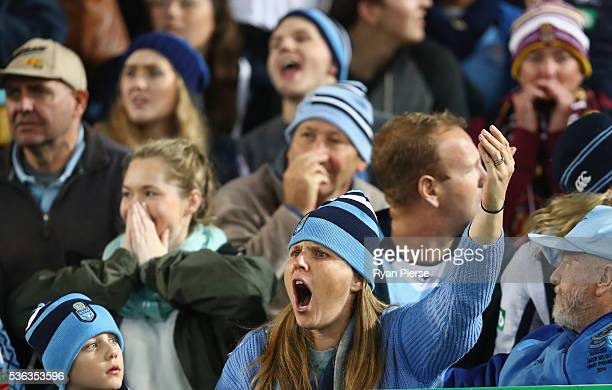 Blues fans react during game one of the State Of Origin series between the New South Wales Blues and the Queensland Maroons at ANZ Stadium on June 1...