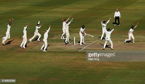 Blues fielders surround Scott Boland of the Bushrangers faces Arjun Nair of the Blues during day four of the Sheffield Shield match between Victoria...
