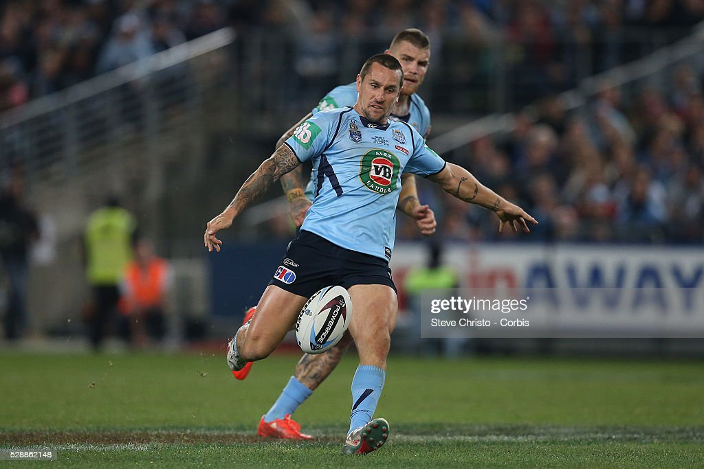 Blue's five-eight Mitchell Pearce kicks ahead against the Maroons during the match at Sydney Olympic Park. Sydney, Australia. Wednesday, 27th May 2015