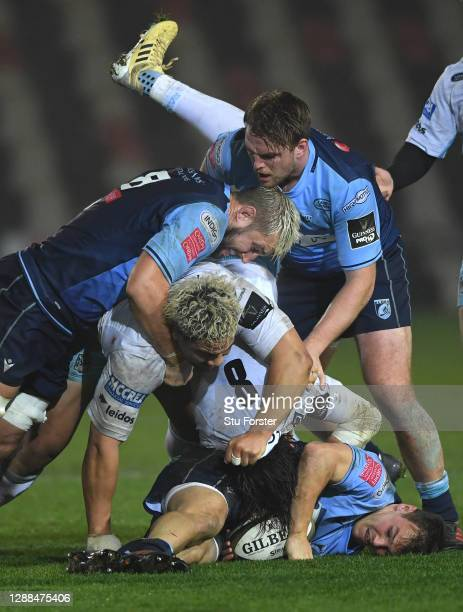 Blues fly half Jarrod Evans is stopped in his tracks by Glasgow Warriors players Ryan Wilson and Aki Seiuli during the Guinness PRO14 match between...