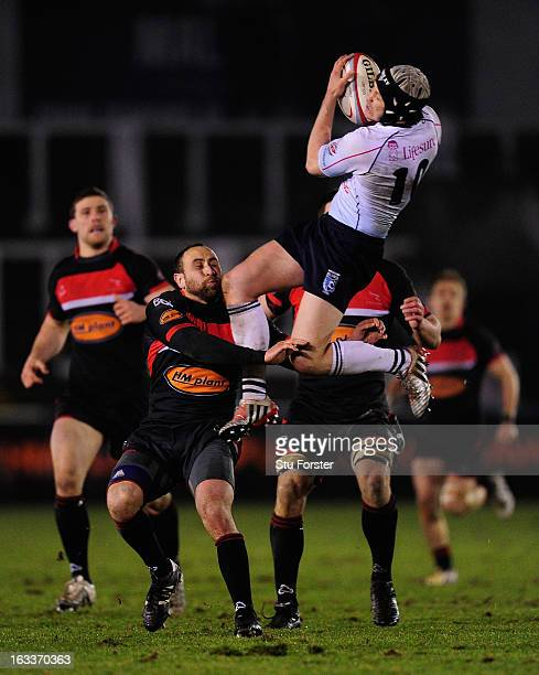 Blues flyhalf Myles Dorrian crashes into Falcons centre Jamie Helleur during the RFU Championship match between Newcastle Falcons and Bedford Blues...