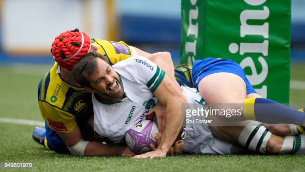 Blues forward Seb Davies can't stop Conrad Smith of Pau touching down for their first try during the European Challenge Cup SemiFinal match between...