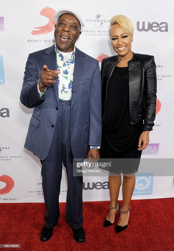 Blues guitarist Buddy Guy and singer Emeli Sande arrive at the NARM Music Biz Awards dinner party at the Hyatt Regency Century Plaza on May 9, 2013 in Century City, California.
