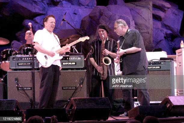 """Blues guitarist, singer and songwriter Jimmie Vaughan and special guest Duke Robbilard are shown performing on stage during a """"live"""" concert..."""