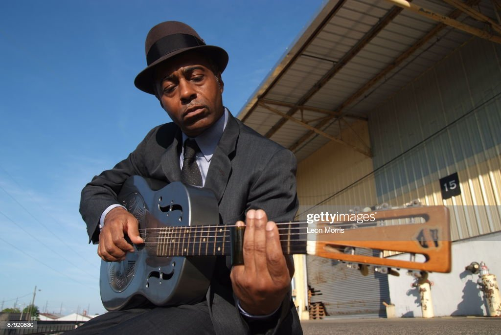 Blues guitarist Vasti Jackson poses as generic delta blues musician on railroad tracks on April 29, 2009 in New Orleans, Louisiana.