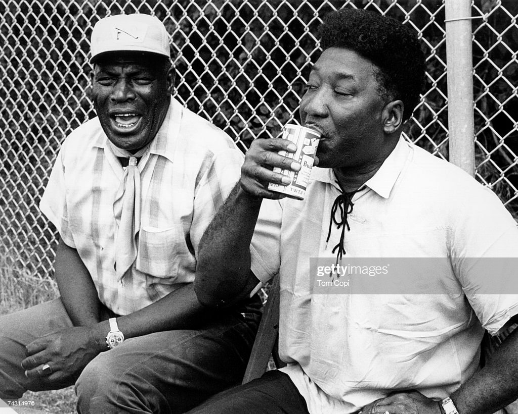 Blues Guitarists and singers Muddy Waters and Howlin' Wolf relax backstage at the Ann Arbor Blues Festival in August 1969 in Ann Arbor, Michigan.