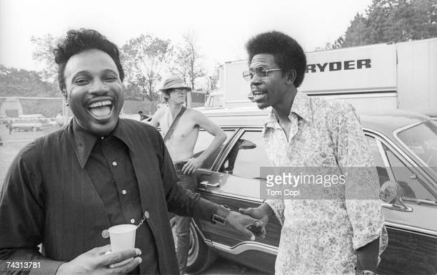 Blues guitarists Otis Rush and Luther Allison share a laugh at the Ann Arbor Blues Festival on August 9, 1970 in Ann Arbor, Michigan.