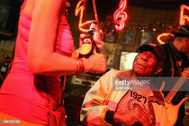 Blues harmonica player songwriter and vocalist Cadillac John Nolden is greeted by a fan before performing at Red's on his 86th birthday April 12 2013...