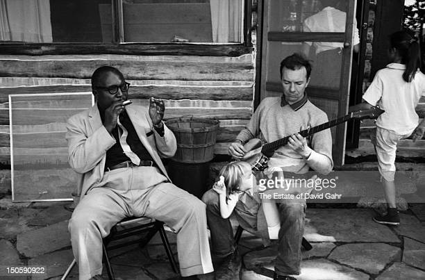Blues harpist Sonny Terry and folk musician Pete Seeger play music together joined by members of Pete Seeger's family in September 1958 at Pete...