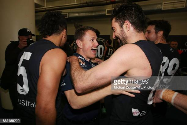 Blues head coach Brendon Bolton celebrates the win Kade Simpson of the Blues during the round 22 AFL match between the Carlton Blues and the Hawthorn...