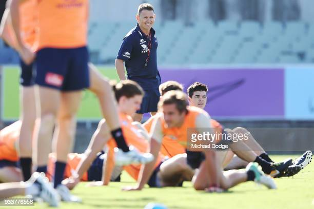 Blues head coach Brendon Bolton looks upfield during a Carlton Blues AFL training session at Ikon Park on March 19 2018 in Melbourne Australia