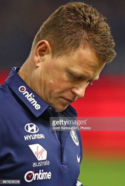 Blues head coach Brendon Bolton speaks to his team during a quarter time break during the round 17 AFL match between the St Kilda Saints and the...