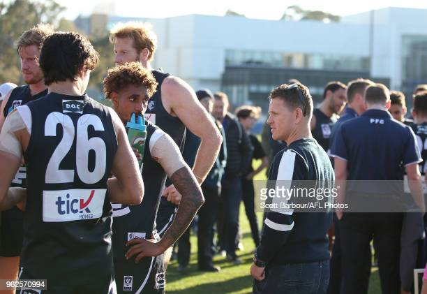Blues head coach Brendon Bolton speaks to players during a quarter time break during the round eight VFL match between the Northern Blues and...