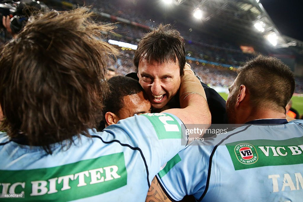 Blues head coach Laurie Daley celebrates with Blues players during game two of the State of Origin series between the New South Wales Blues and the Queensland Maroons at ANZ Stadium on June 18, 2014 in Sydney, Australia.