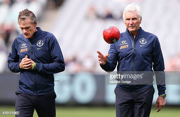 Blues head coach Michael Malthouse and his assistant Dean Laidley walk off after warm up during the round three AFL match between the Carlton Blues...