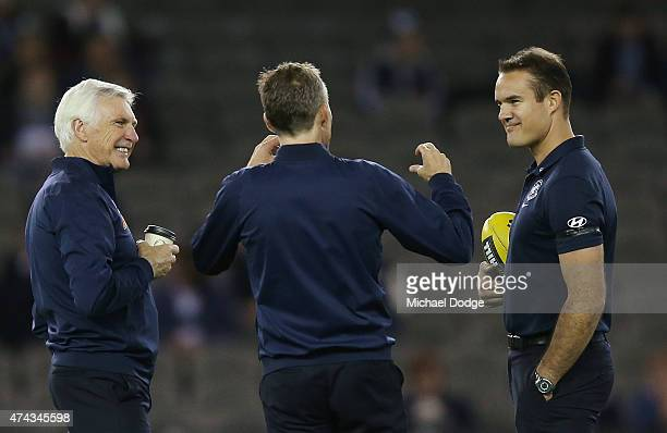 Blues head coach Michael Malthouse has a coffee in the warm up with assistants Dean Laidley and Brad Green during the round eight AFL match between...