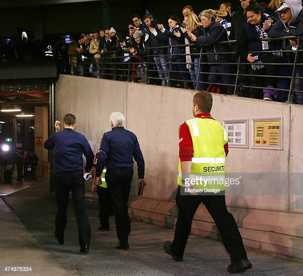 Blues head coach Michael Malthouse walks off after defeat with assistant coach Dean Laidley during the round eight AFL match between the Geelong Cats...