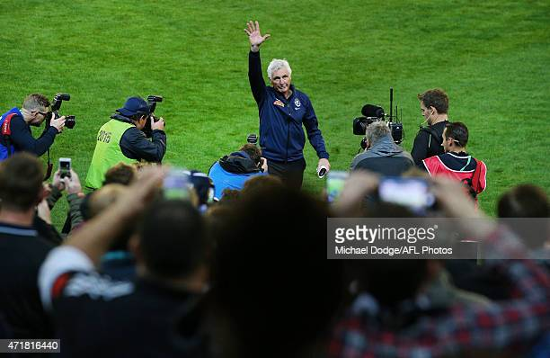Blues head coach Michael Malthouse walks off the ground through a Guard Of Honor formed by players after his record 715th game as a coach during the...