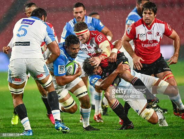 Blues' Jerome Kaino is tackled by Lions' Jaco Kriel during the Super Rugby match between the Golden Lions and the Auckland Blues at the Ellis Park...