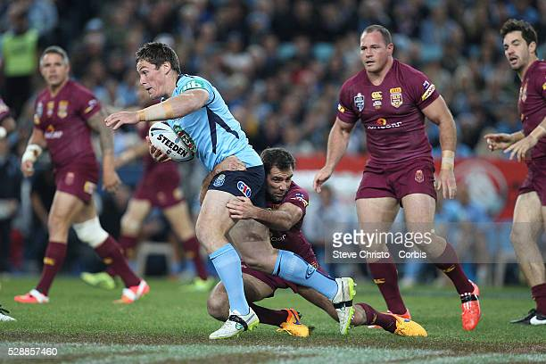 Blue's Josh Jackson is tackled by Maroon's captain Cameron Smith during the match at Sydney Olympic Park Sydney Australia Wednesday 27th May 2015