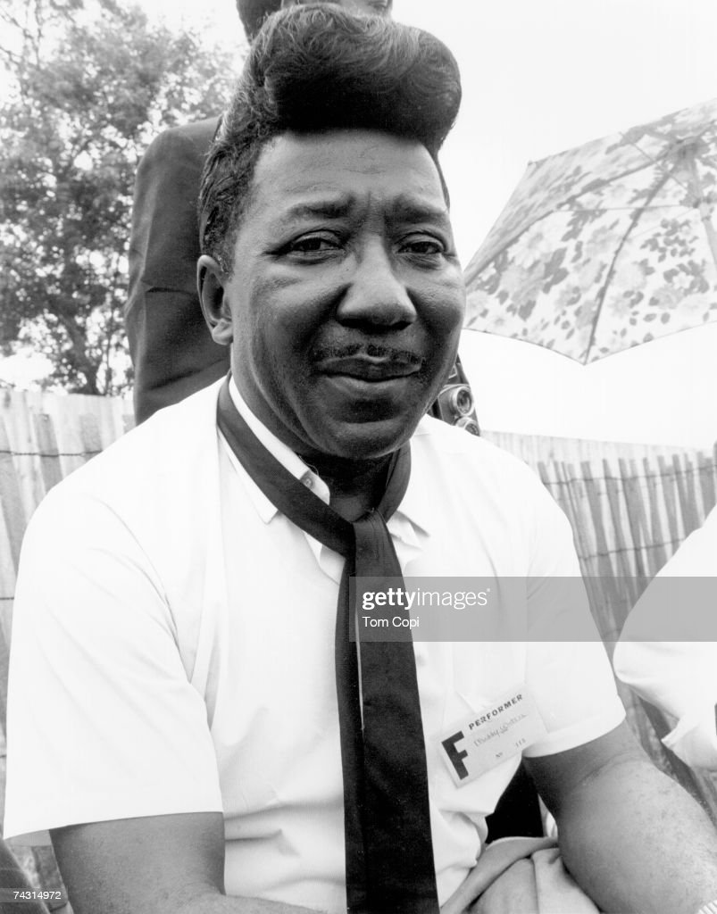 Blues legend Muddy Waters poses for a portrait backstage at the Newport Folk Festival in July 1967 in Newport, Rhode Island.