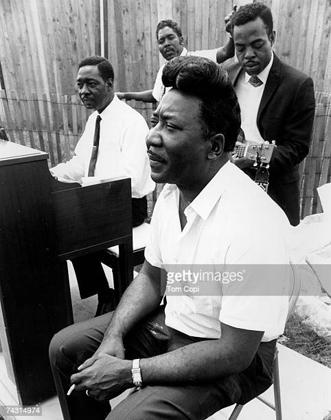 Blues legends the Muddy Waters Blues Band backstage at the Newport Folk Festival in July 1967 in Newport Rhode Island