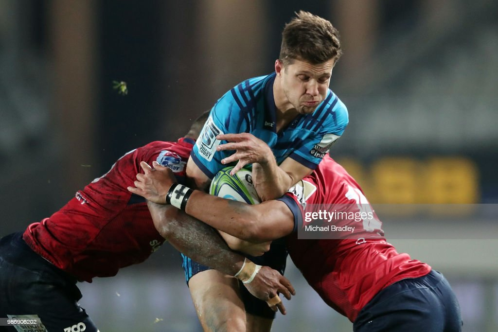 Blues Matt Duffie is tackled during the round 17 Super Rugby match between the Blues and the Reds at Eden Park on June 29, 2018 in Auckland, New Zealand.