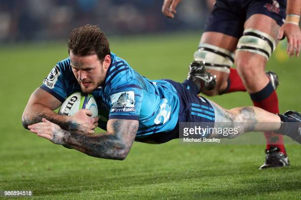 Blues Matt Moulds dives in for a try during the round 17 Super Rugby match between the Blues and the Reds at Eden Park on June 29 2018 in Auckland...