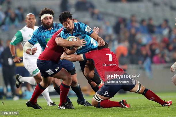 Blues Melani Nanai is tackled by two Red defenders during the round 17 Super Rugby match between the Blues and the Reds at Eden Park on June 29 2018...