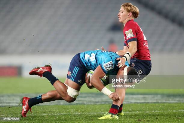 Blues Murphy Taramai is tackled by Reds Tate McDermott during the round 17 Super Rugby match between the Blues and the Reds at Eden Park on June 29...