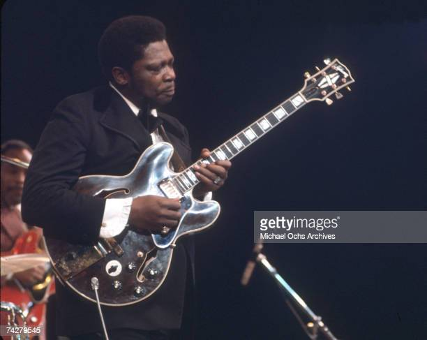Blues musician BB King performs onstage with his 'Lucille' model Gibson hollowbody electric guitar in circa 1968