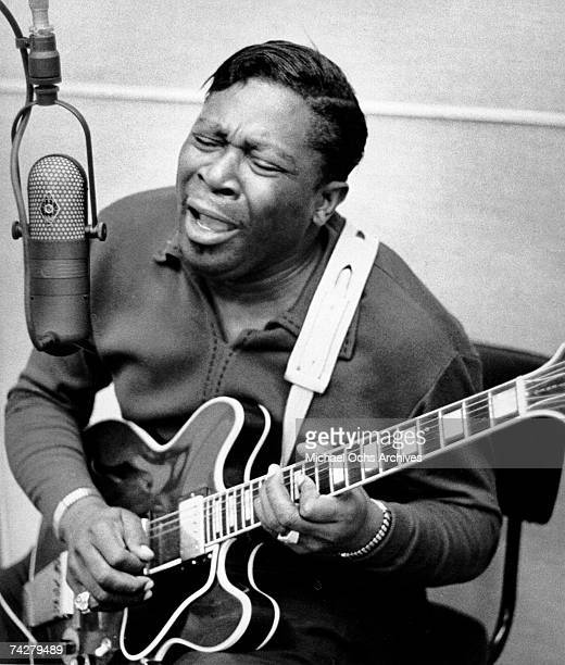Blues musician BB King records in the studio with his 'Lucille' model Gibson hollowbody electric guitar in circa 1960