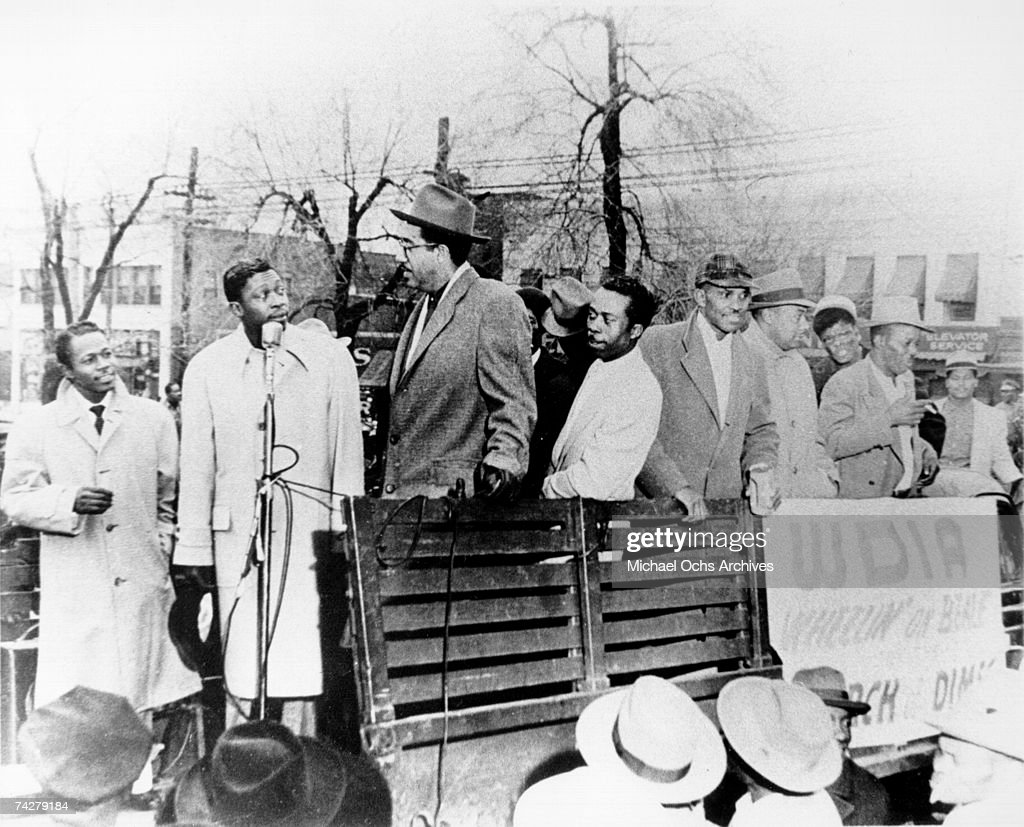 Blues musician B.B. King stands on the back of a truck with other African-American men to raise money for radio station WDIA's Wheelin' On Beale March of Dimes charity for pregnancy and baby health in circa 1955 in Memphis, Tennessee.