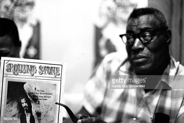 Blues musician Howlin' Wolf poses for a portrait in a hotel room holding a copy of Rolling Stone magazine with Frank Zappa on the cover in July 1968...