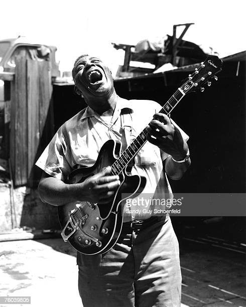 Blues musician Howlin' Wolf poses for a portrait session holding an Epiphone hollowbody electric guitar behind the Fillmore in July 1968 in San...