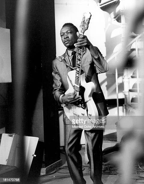 Blues musician John Lee Hooker performs on a TV Show with am Epiphone hollowbody electric guitar in circa 1965
