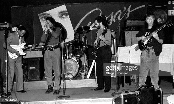 Blues musician Sugar Blue performs onstage at Rosa's Lounge in Chicago Illinois United States on February 19 1992 LR Herb Walker on guitar Sugar Blue...