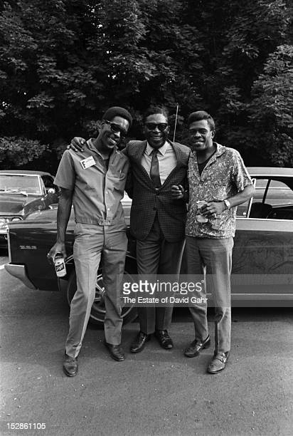 Blues musicians Buddy Guy BB King Junior Wells pose for a portrait in July 1968 at the Newport Folk Festival in Newport Rhode Island