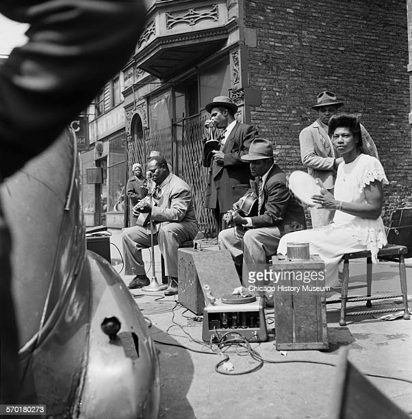 Blues musicians on Maxwell Street in Chicago Illinois circa 1950