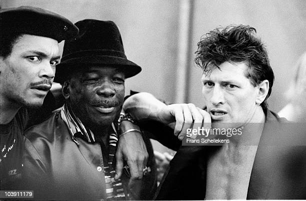 Blues musicians Sugar Blue John Lee Hooker and Herman Brood posed together backstage at the North Sea Jazz Festival in The Hague Holland on July 12...