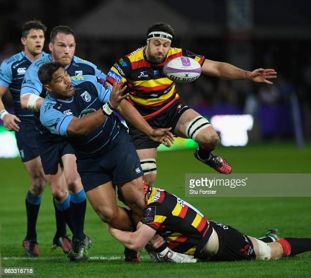 Blues number 8 Nick Williams offloads despite the tackle of Tom Savage during the European Rugby Challenge Cup match between Gloucester Rugby and...