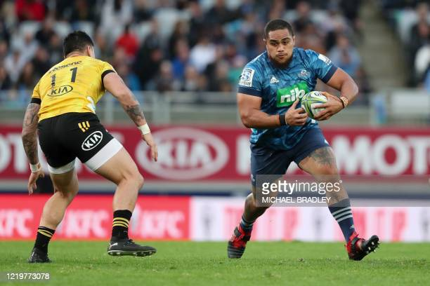 Blues' Ofa Tuungafasi makes a run during the Super Rugby match between the Auckland Blues and Wellington Hurricanes at Eden Park stadium in Auckland...